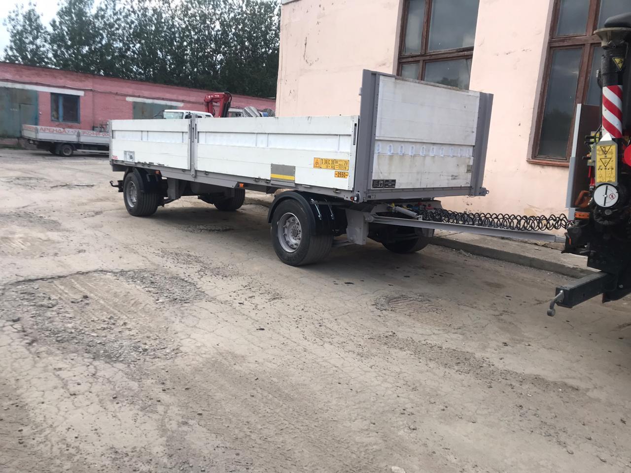 Бортовой прицеп с аппарелями для перевозки негабаритов и спецтехники массой до 15 тонн